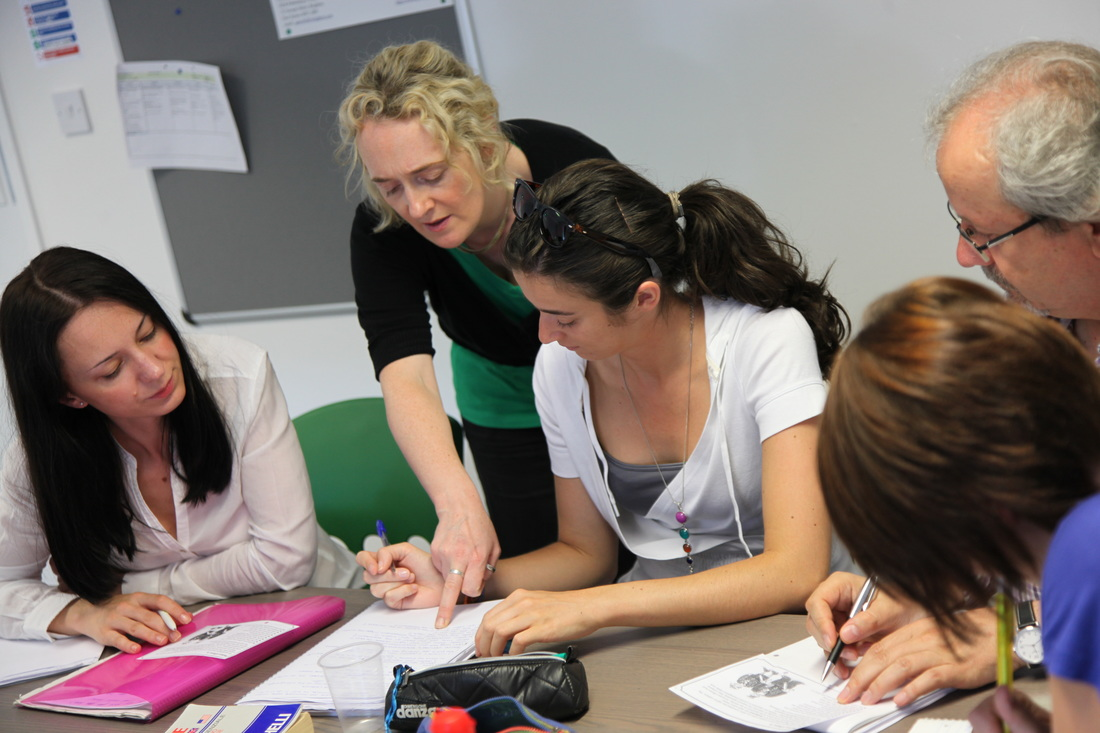 Open group course, teacher and students, ABC Languages