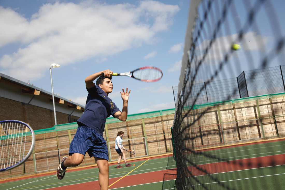 Image: Playing tennis at our summer centre